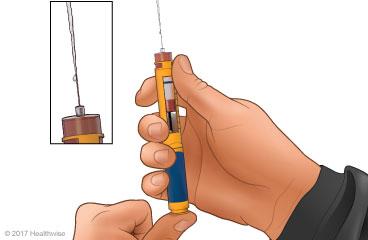 Purgación de la aguja, con primer plano de la insulina saliendo de la aguja