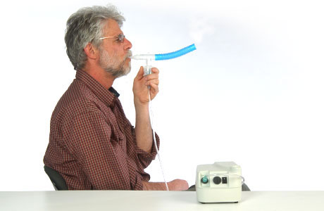 A man using a nebulizer