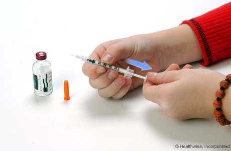 Drawing air into the syringe