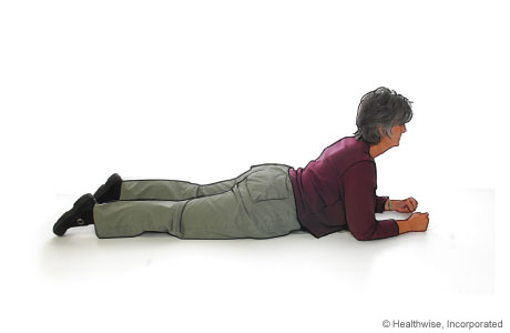 Press-up back extension for ankylosing spondylitis (front of hips on floor)