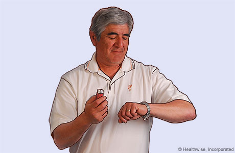 Picture of a man holding his breath and looking at his watch to count 10 seconds