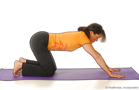 Picture of a woman in step two of yoga extended puppy pose