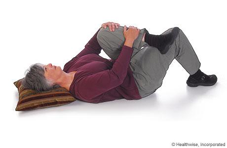 Imagen de cómo hacer el ejercicio de estiramiento del músculo piriforme